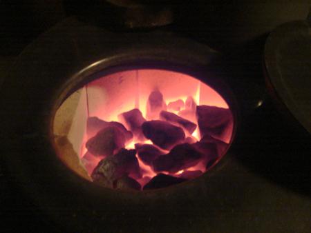 The sauna stove stones glowing cherry red.
