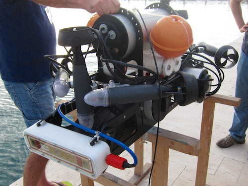 A prototype robotic dive buddy. The white box in front is a medical grade ultrasound scanner accurate enough that it can detect diver hand signs.