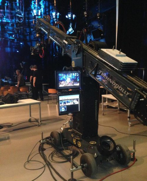 This is a robot camera crane / dolly, and one of the teams designed a lightsaber training game for it.