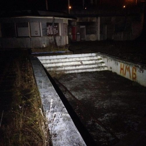 A surprising abandoned waterpark appears. Anyone feel like a swim?